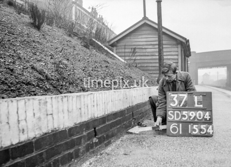 SD590437L, Man marking Ordnance Survey minor control revision point with an arrow in 1950s