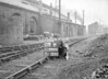 SD590409B, Man marking Ordnance Survey minor control revision point with an arrow in 1950s