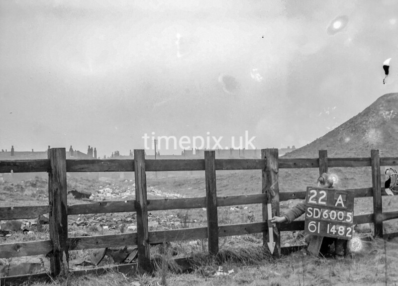 SD600522A1, Man marking Ordnance Survey minor control revision point with an arrow in 1950s