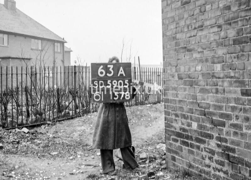 SD590563A, Man marking Ordnance Survey minor control revision point with an arrow in 1950s