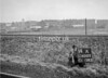 SD600314A, Man marking Ordnance Survey minor control revision point with an arrow in 1950s