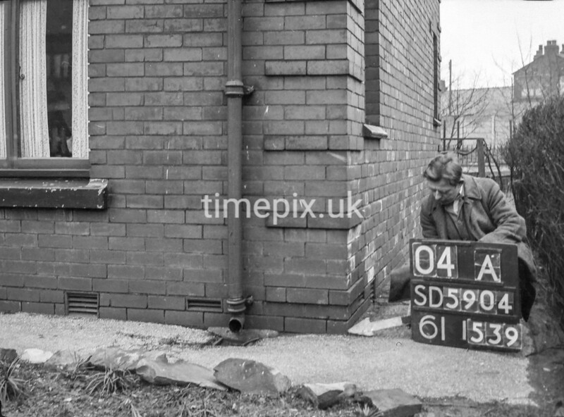 SD590404A, Man marking Ordnance Survey minor control revision point with an arrow in 1950s