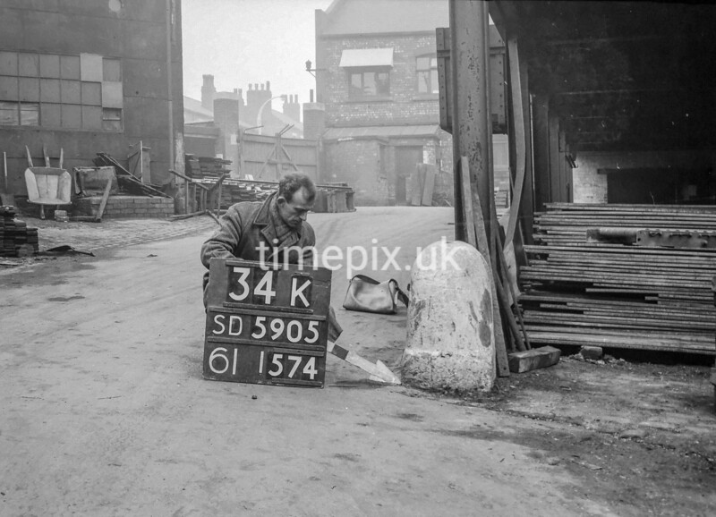 SD590534K, Man marking Ordnance Survey minor control revision point with an arrow in 1950s