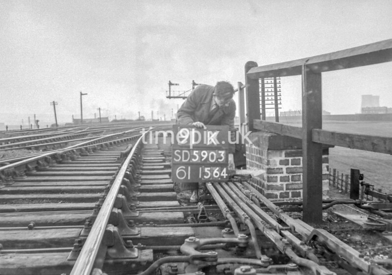 SD590391K, Man marking Ordnance Survey minor control revision point with an arrow in 1950s