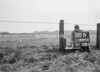 SD600400B, Man marking Ordnance Survey minor control revision point with an arrow in 1950s