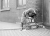 SD590535K, Man marking Ordnance Survey minor control revision point with an arrow in 1950s