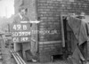 SD590449B, Man marking Ordnance Survey minor control revision point with an arrow in 1950s
