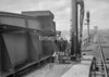 SD580504L, Man marking Ordnance Survey minor control revision point with an arrow in 1950s