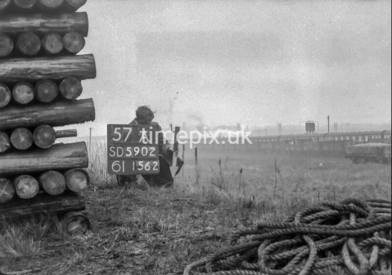 SD590257A, Man marking Ordnance Survey minor control revision point with an arrow in 1950s