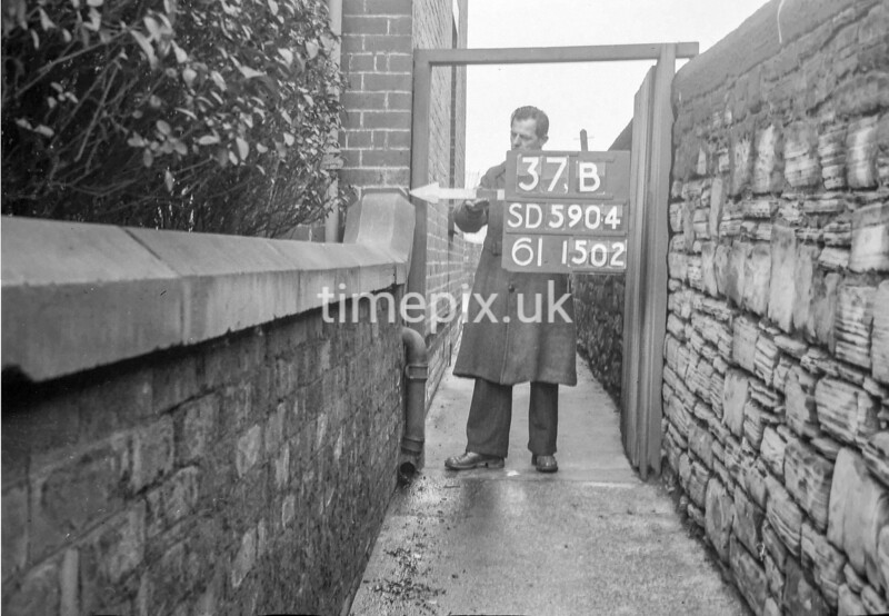 SD590437B, Man marking Ordnance Survey minor control revision point with an arrow in 1950s