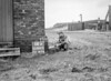 SD610518A, Man marking Ordnance Survey minor control revision point with an arrow in 1950s