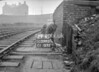 SD590329A, Man marking Ordnance Survey minor control revision point with an arrow in 1950s