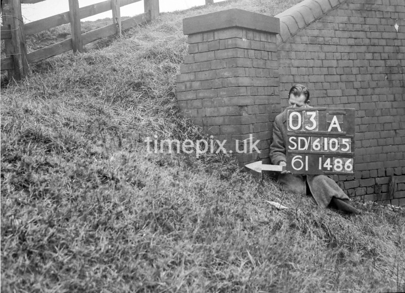 SD610503A, Man marking Ordnance Survey minor control revision point with an arrow in 1950s