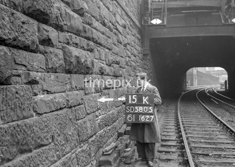 SD580515K, Man marking Ordnance Survey minor control revision point with an arrow in 1950s