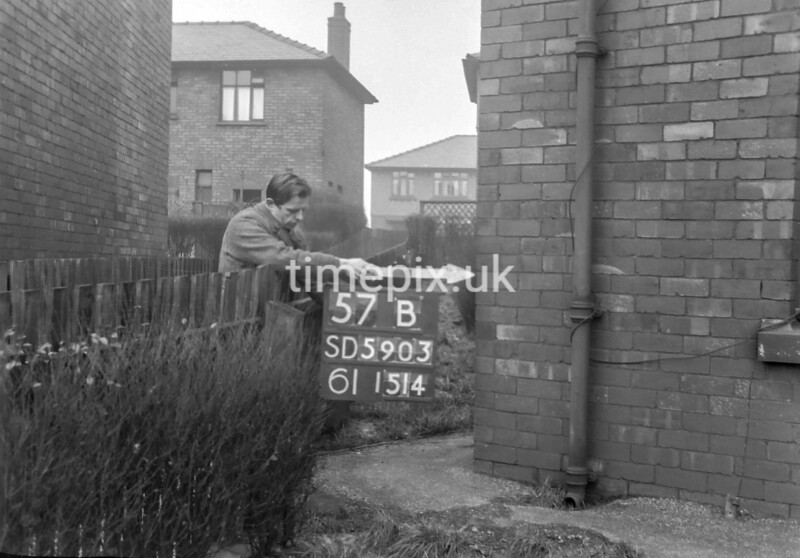 SD590357B, Man marking Ordnance Survey minor control revision point with an arrow in 1950s