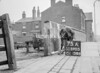 SD590575A, Man marking Ordnance Survey minor control revision point with an arrow in 1950s