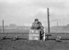 SD590474A, Man marking Ordnance Survey minor control revision point with an arrow in 1950s