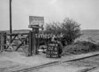 SD570802B, Man marking Ordnance Survey minor control revision point with an arrow in 1950s