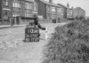SD570710A, Man marking Ordnance Survey minor control revision point with an arrow in 1950s
