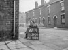 SD590622B, Man marking Ordnance Survey minor control revision point with an arrow in 1950s