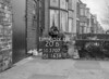 SD570720B, Man marking Ordnance Survey minor control revision point with an arrow in 1950s