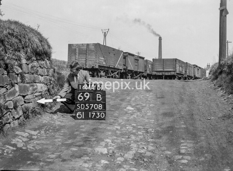 SD570869B, Man marking Ordnance Survey minor control revision point with an arrow in 1950s