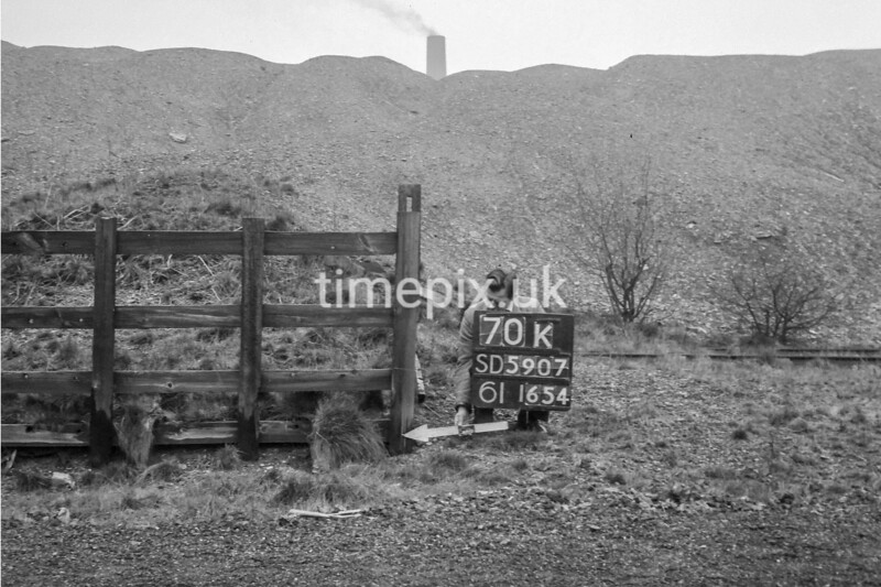 SD590770K, Man marking Ordnance Survey minor control revision point with an arrow in 1950s