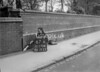 SD570867A, Man marking Ordnance Survey minor control revision point with an arrow in 1950s