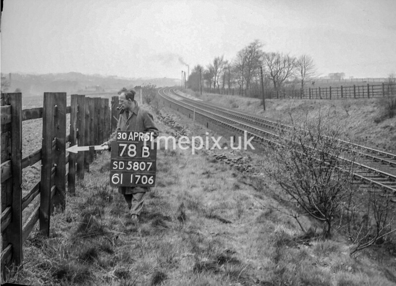 SD580778B, Man marking Ordnance Survey minor control revision point with an arrow in 1950s