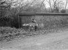 SD580787B, Man marking Ordnance Survey minor control revision point with an arrow in 1950s