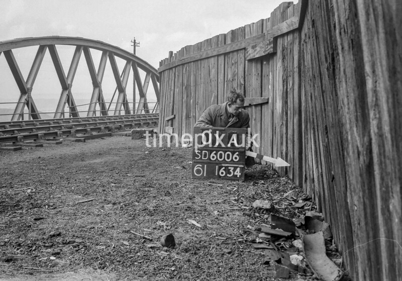 SD600601A, Man marking Ordnance Survey minor control revision point with an arrow in 1950s