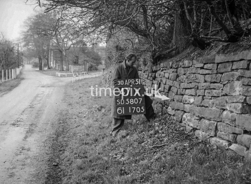 SD580747A, Man marking Ordnance Survey minor control revision point with an arrow in 1950s