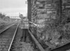 SD570876K, Man marking Ordnance Survey minor control revision point with an arrow in 1950s