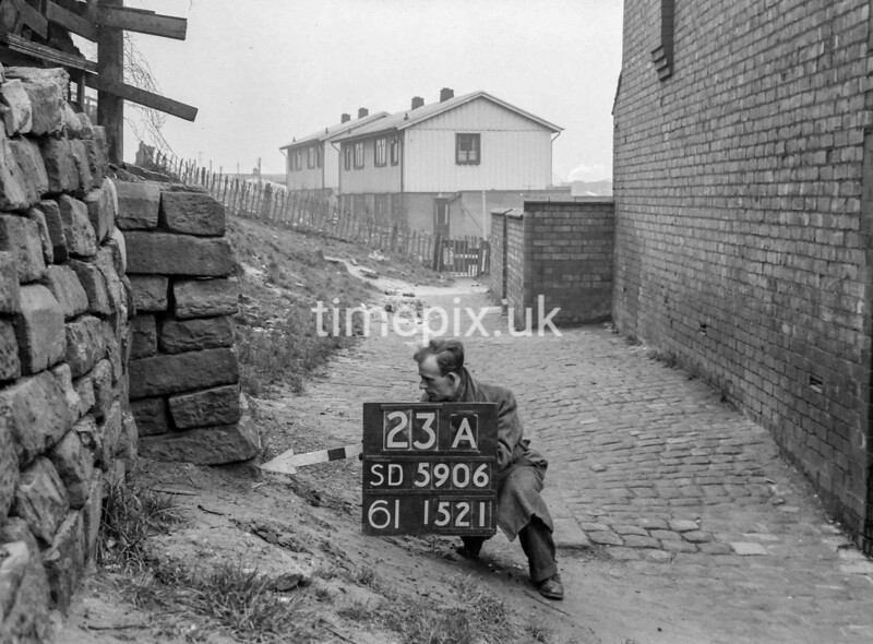 SD590623A, Man marking Ordnance Survey minor control revision point with an arrow in 1950s