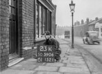 SD590623K, Man marking Ordnance Survey minor control revision point with an arrow in 1950s