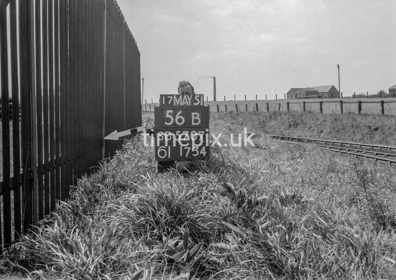 SD570756B, Man marking Ordnance Survey minor control revision point with an arrow in 1950s