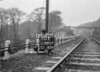 SD590770L, Man marking Ordnance Survey minor control revision point with an arrow in 1950s