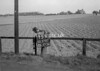 SD570715A, Man marking Ordnance Survey minor control revision point with an arrow in 1950s