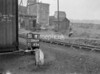 SD590751B, Man marking Ordnance Survey minor control revision point with an arrow in 1950s