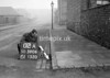 SD590602A, Man marking Ordnance Survey minor control revision point with an arrow in 1950s