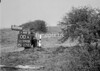 SD590800A, Man marking Ordnance Survey minor control revision point with an arrow in 1950s