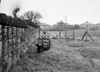 SD590607A, Man marking Ordnance Survey minor control revision point with an arrow in 1950s