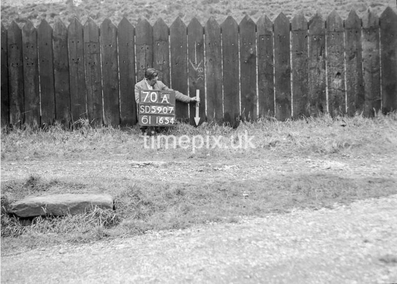 SD590770A, Man marking Ordnance Survey minor control revision point with an arrow in 1950s