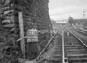SD570876L, Man marking Ordnance Survey minor control revision point with an arrow in 1950s