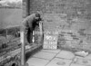 SD590790A, Man marking Ordnance Survey minor control revision point with an arrow in 1950s