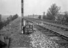 SD570666B, Man marking Ordnance Survey minor control revision point with an arrow in 1950s