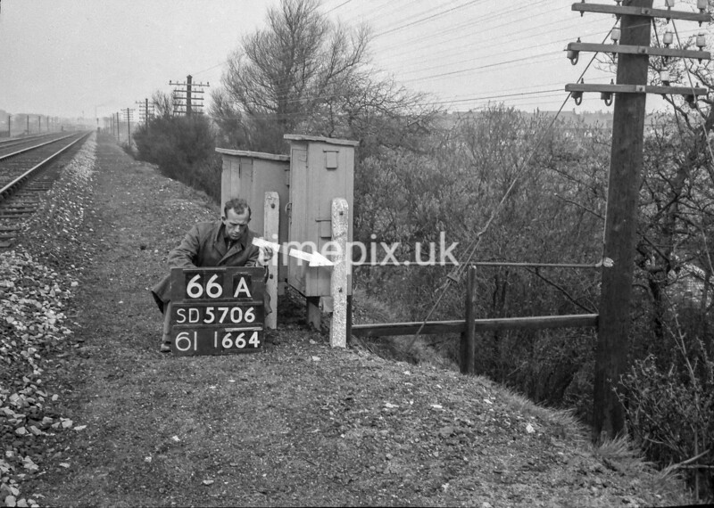 SD570666A, Man marking Ordnance Survey minor control revision point with an arrow in 1950s