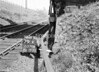 SD570879K, Man marking Ordnance Survey minor control revision point with an arrow in 1950s