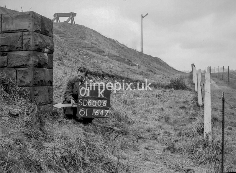SD600601K, Man marking Ordnance Survey minor control revision point with an arrow in 1950s