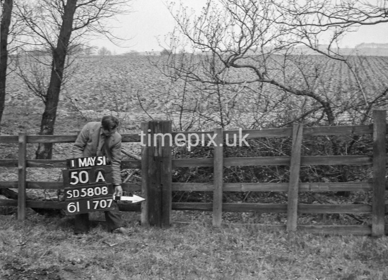 SD580850A, Man marking Ordnance Survey minor control revision point with an arrow in 1950s
